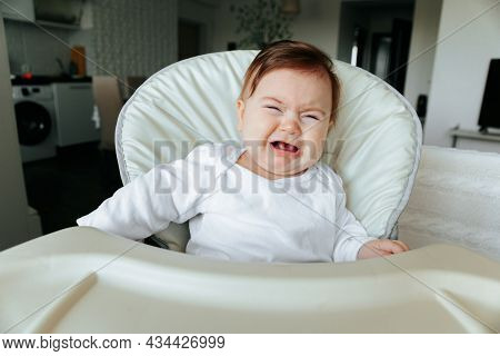 Angry Little Baby With Sad Expressions, Screaming And Crying. At Home, Living Room. Child Is Upset A