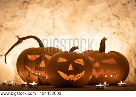 Jack O' Lanterns glowing in smoky fantasy night. Halloween background