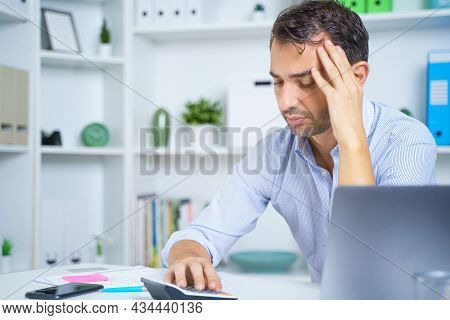 One Man Sit At Desk Paying Bills Feel Stressed Having Financial Problems
