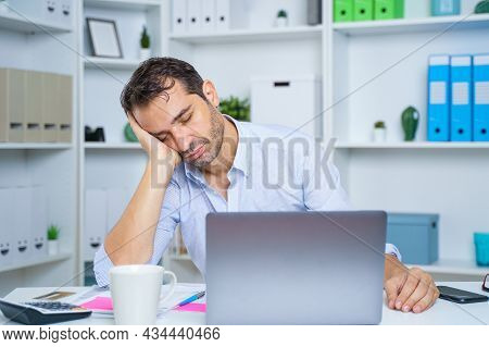 One Unproductive Lazy Worker Sleeping In Workplace