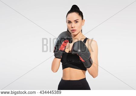 Strong Young Sportswoman In Boxing Gloves Isolated On Grey