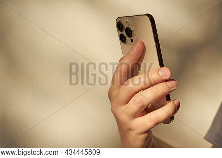 Turku, Finland- 26 September, 2021: New Smartphone Iphone 13 Pro Max Gold Color In The Hand Of A Man