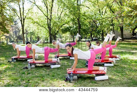 Group of young women doing exercises for buttocks
