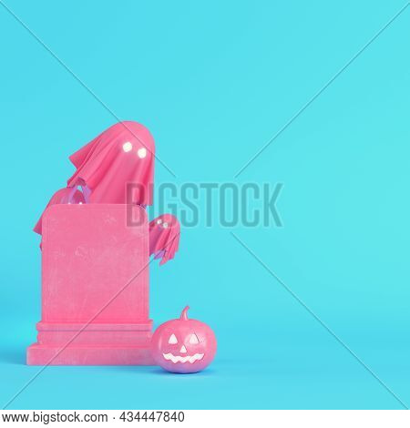 Pink Halloween Pumpkin With Ghosts And Gravestone On Bright Blue Background In Pastel Colors. Minima