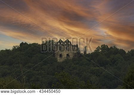 The Hill Is Covered With Deciduous Forest. At The Top You Can See The Stone Walls Of The Ruins Of A