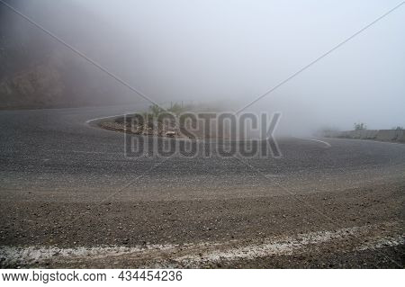Serpentine Tar Road Covered With Morning Mist In High Mountain Of Caucasus In Chechnya, Russia. Chec