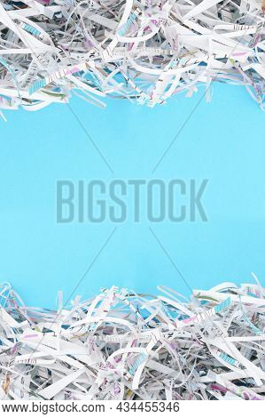 The Shredded Paper On Light Blue Background.