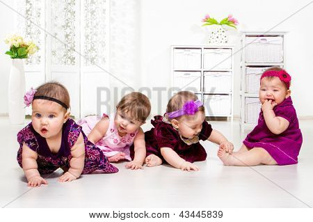 Beautiful baby girls group in festive dresses