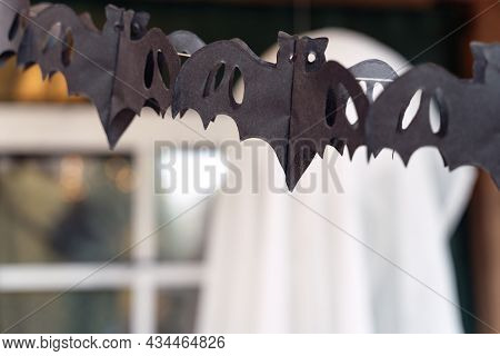 Black Paper Cut Out Garland In Shape Of Flying Bats.burning Lantern.decorating Of Porch Outdoor On S