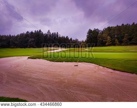 View Of A Nice Golf Course With A Bunker And A Nice Green, Photo