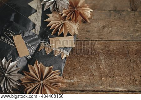 Stylish Christmas Gifts With Modern Simple Decorations On Rustic Wooden Table. Xmas Present Wrapped
