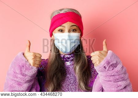 Covid-19, Virus And Fashion Concept. Close-up Of Fashionable Asian Senior Woman In Face Mask, Showin
