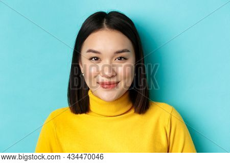 Beauty And Skin Care Concept. Close Up Of Beautiful Young Asian Woman With Perfect Face, Without Ble