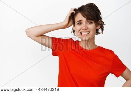 Indecisive Brunette Woman Looks Puzzled, Confused With Smth, Scratching Head And Looking Perplexed,