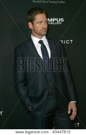 """LOS ANGELES - MARCH 18: Gerard Butler arrives at the premiere of """"Olympus Has Fallen"""" at the ArcLight Hollywood Theatre in Los Angeles, CA on March 18, 2013."""