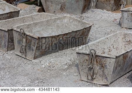 Empty Cement Mortar In Construction Tanks. Construction Site. Construction Equipment. Bricks