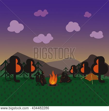 Evening Landscape In The Meadow Near The Forest And Mountains. People Are Sitting Near Campfire. Sun