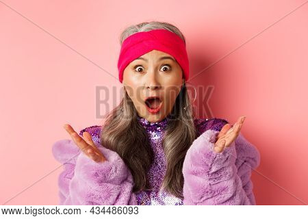 Fashion. Close-up Of Fashionable Asian Elderly Woman Reacting To Special Offer, Scream And Gasping S
