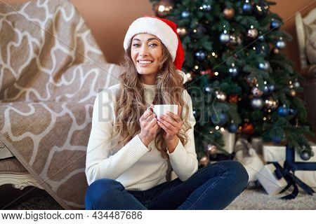 Christmas Woman Dressed White Sweater Santa Hat Sitting Floor Near Christmas Tree Wrapped Herself Bl