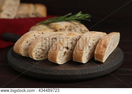 Board With Cut Delicious Ciabatta On Wooden Table