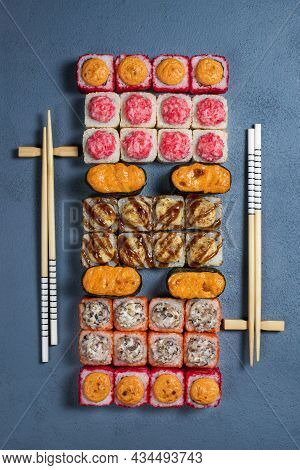 Overhead Japanese Sushi Food. Maki Ands Rolls With Tuna, Salmon, Shrimp, Crab And Avocado. Top View