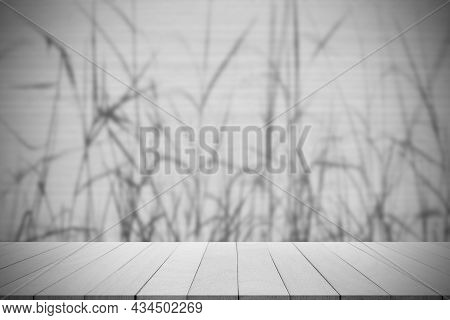 Empty Wooden Table On Shadow Leaves Grass Black And White Background. Blank Room Studio Counter For
