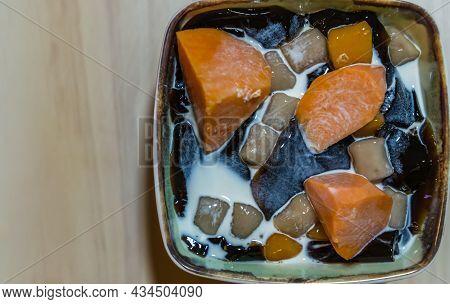 Traditional Taiwanese Iced Dessert With Grass Jelly, Taro Balls, Tofu Pudding, Sweet Potato Balls An