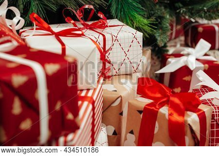 Pile Of Wrapped Presents Under The Christmas Tree