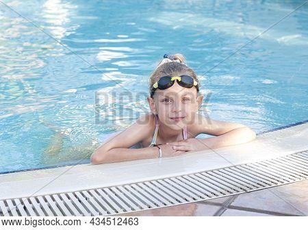 Little Girl Swiming In The Pool