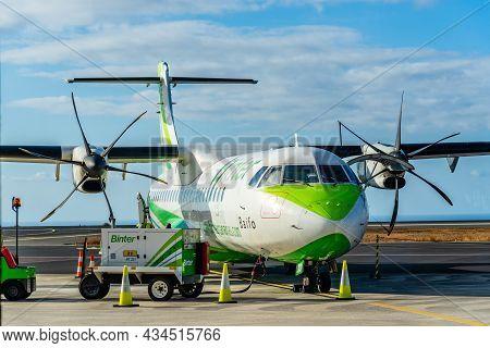La Gomera, Spain - August 12, 2021: Propeller Airplane Provisioning On The Runway. Atr 72 Plane Of B