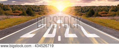 Empty Asphalt Road And New Year 2022 Concept. Driving On An Empty Road To Goals 2022 With Sunset. 20