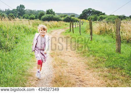 Happy Little Toddler Girl Running In Nature, Summer Walk Through Fields, Outdoors. Funny Preschool C