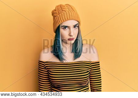 Young modern girl wearing wool hat skeptic and nervous, frowning upset because of problem. negative person.