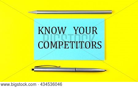Text Know Your Competitors On The Blue Sticker On Yellow Background