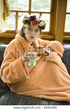 Beautiful Girl In Hair Curlers With A Cup Of Tea.
