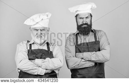 Restaurant Kitchen. Culinary Industry. Restaurant Staff. Father And Son Culinary Hobby. Mature Beard