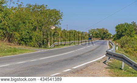 Empty Regional Tarmac Road In Serbia Sunny Summer Day