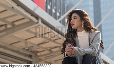 Lay Off. Sacked. Fired Business Woman Sitting On Stairs Of Office Building Outside.