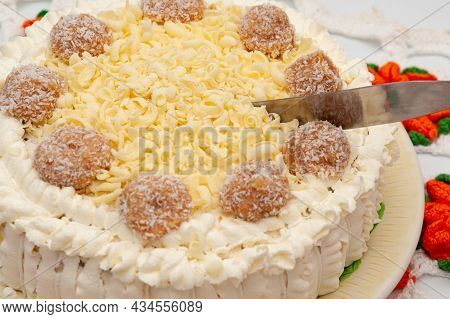 Delicious Homemade Stuffed Chocolate Cake Decorated With Grated White Chocolate And Dulce De Leche C