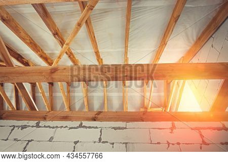 Wooden Roof Structures Of A New Residential Building. Construction Of A Residential Building Under C