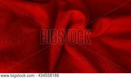 Background With Wavy Lines From Natural Silk Fabric Of Red Color. Red Fabric Background. Background