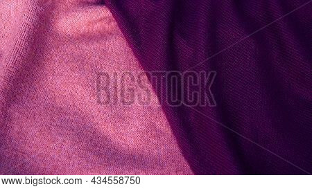 Background In Pastel Shades Of Pink And Purple From Silk Fabric. Textile, Copy Space From Silk Fabri