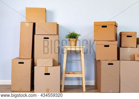 Moving Boxes With Packed Stuff And Chair For Moving