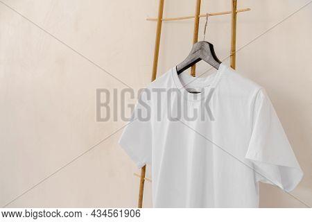 Plain White Cotton T-shirt On Hanger For Your Design