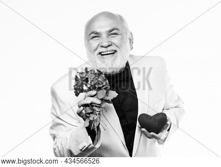 Health Treatment. Problems With Heart. Businessman. Heart Failure. Happy Mature Man Hold Flowers And