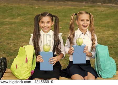 We Are Vegetarian. Happy Children Hold Green Apples Outdoors. Eating Fruits For Snack. Vegetarian Fo