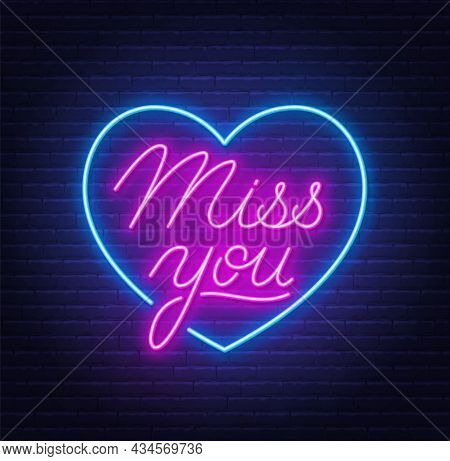 Miss You Neon Quote On Brick Wall Background.