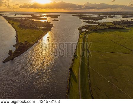 Aerial View Of River Ijsssel And Ketelmeer With Small Islands And Wetlands In The Late Evening Sun