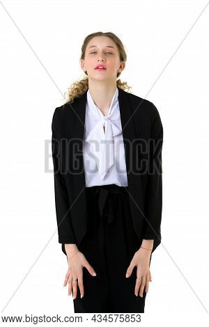 Portrait Of Surprised Girl In Elegant Black Suit. Pretty Girl With Open Mouth Looking To The Side, S