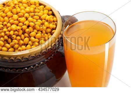 Yellow Fresh Sea Buckthorn And Fresh Sea Buckthorn Juice In Glass Beaker As A Symbol Of Fresh Health